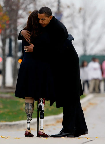 President-elect Barack Obama, right, hugged Iraq war veteran Tammy Duckworth after a wreath laying ceremony at the Bronze Soldiers Memorial in Chicago in honor of Veteran's Day. Ms. Duckworth is the director of the Illinois Department of Veterans Affairs. NYT.