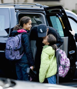 In this Nov. 10, 2008 file photo, Sasha Obama and Malia Obama, the children of President-elect Barack Obama, not pictured, walk to school after their father dropped them off in Chicago. Malia and Sasha are in Washington with their mother checking out new schools. AP