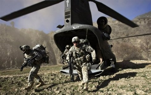 "US soldiers hunt for Taliban and Al-Qaeda militants in Afghanistan's Khost province. President Hamid Karzai has told the UN Security Council that the international community sets a ""timeline"" for ending military intervention in Afghanistan."