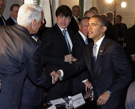 President-elect Barack Obama shakes hands with Florida Governor Charlie Crist as Illinois Governor Rod Blagojevich looks on during a bipartisan meeting
