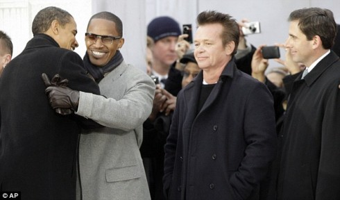 Mr Obama greets actor Jamie Foxx as singer John Mellencamp and comedian Steve Carell look on